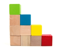 image of child's blocks forming stair steps